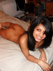 Shaved Indian babe nude and spreading at home